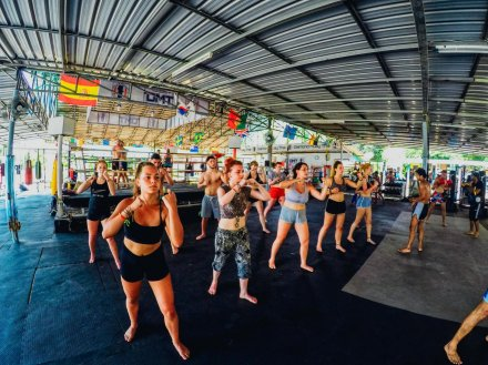 A group practicing muay Thai moves at a class in Koh Phangan Thailand