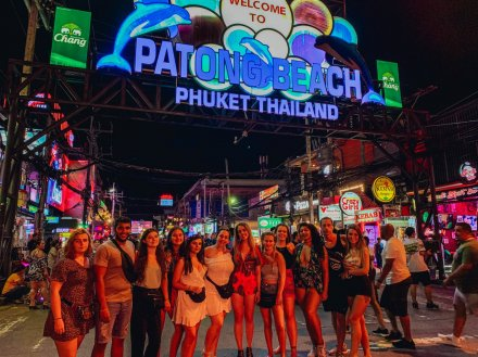 A group picture at the lively and colourful streets by Patong beach Thailand