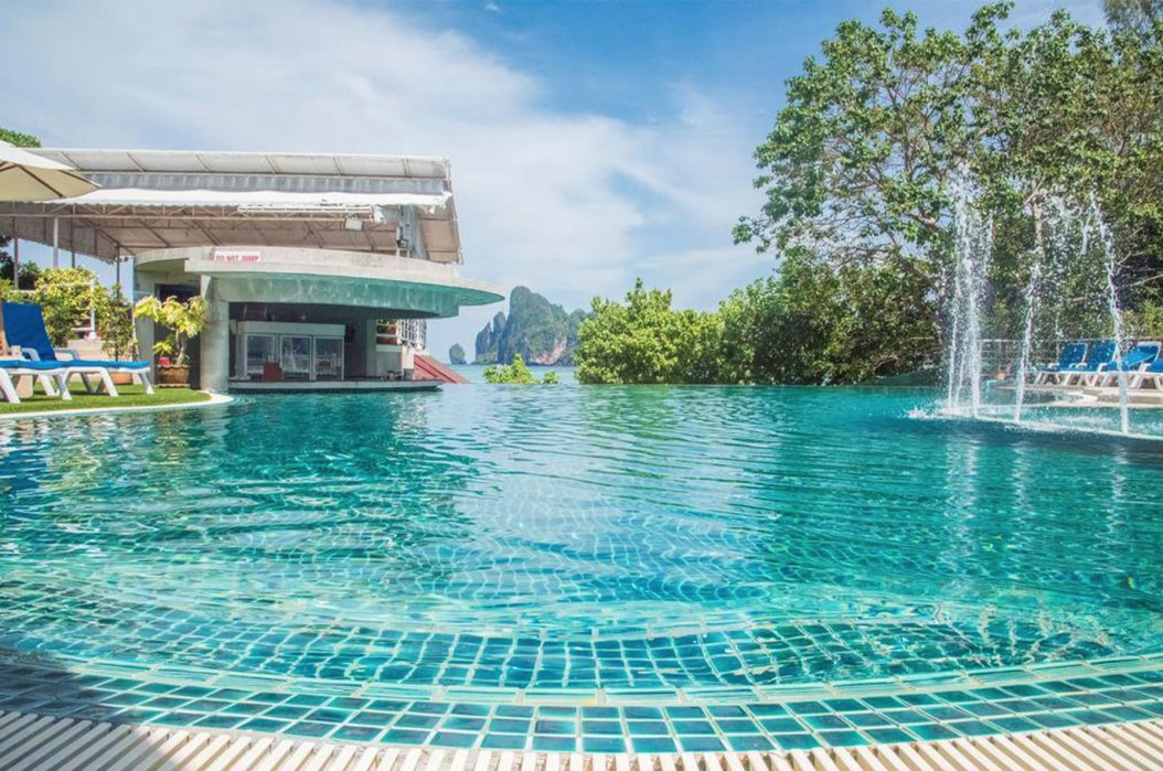 A shot of the gorgeous glistening blue swimming pool with fountains at the hotel in Koh Phi Phi, Thailand