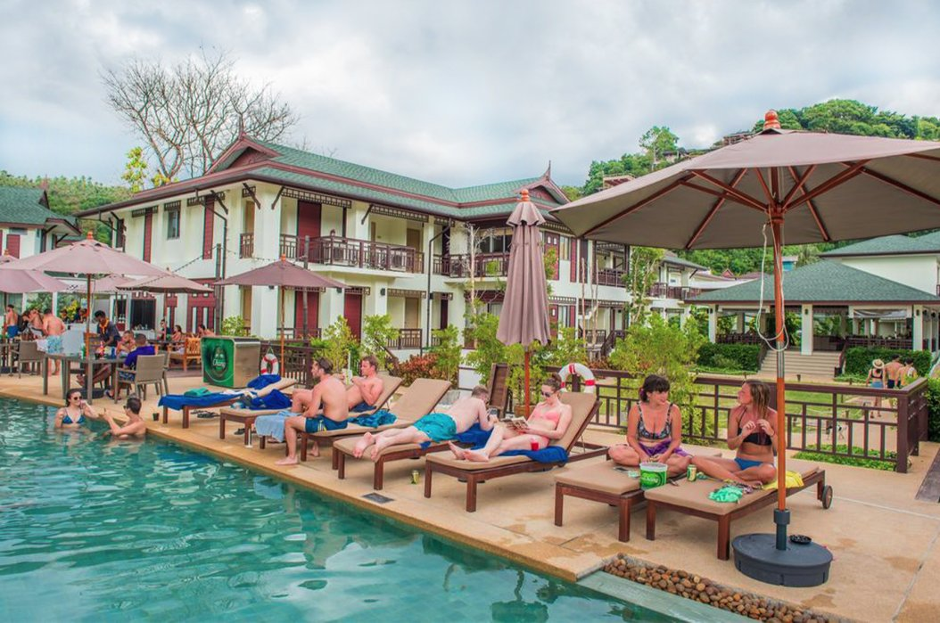 A shot of people lounging by the turquoise pool at the hotel in Koh Phi Phi, Thailand