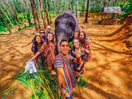 A group selfie with an elephant at the elephant sanctuary in Thailand