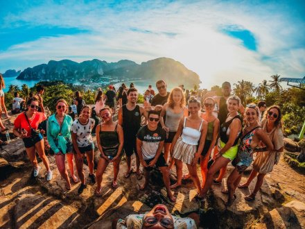 A group selfie at the viewpoint in Koh Phi Phi, Thailand just as the sun starts to set