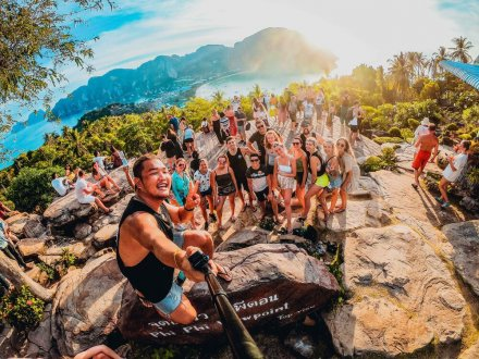 A group selfie at the viewpoint in Koh Phi Phi, Thailand as the sun is about to set