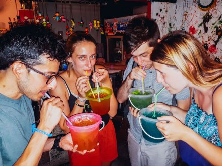 A group in Bangkok Thailand drinking out of the infamous bucket