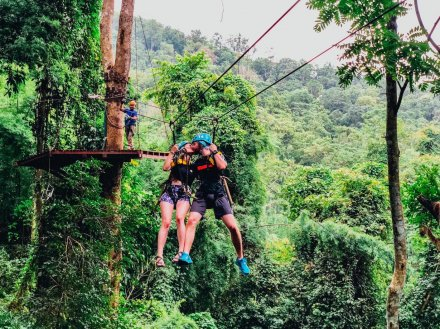 A couple having a moment on the zip line in Chiang Mai Thailand