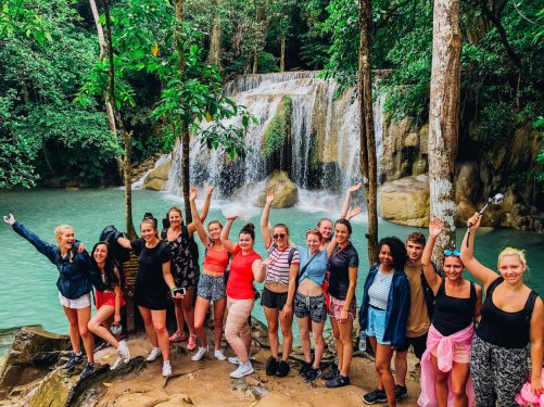 A group photo at the waterfall in Erawan falls Thailand