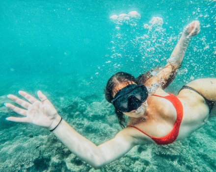 A girl snorkeling in the crystal clear water in Koh Phi Phi Thailand