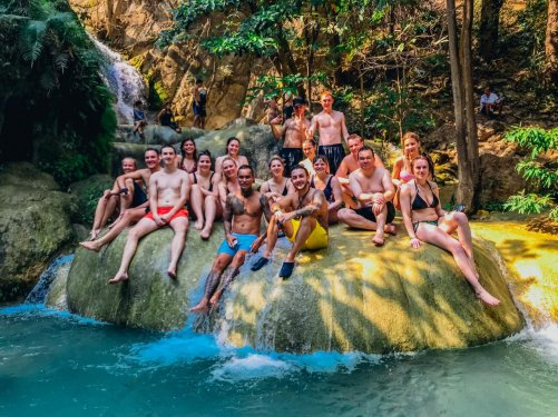 A group shot on a rock at Erawan falls in Thailand