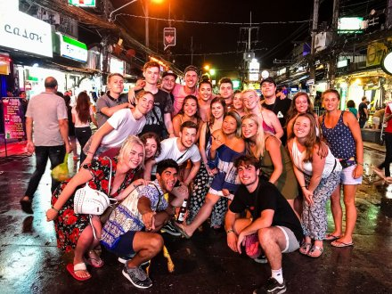 A group taking in the nightlife Phuket has to offer during the island hopper in Thailand