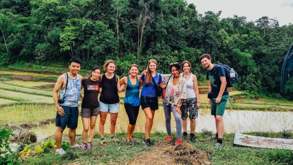 A group photo during the jungle trek before the hill tribe stay in Thailand Chiang Mai