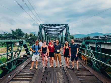A group photo on the bridge over river Kwai in Kanchanaburi