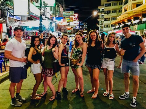 A group enjoying the night life on Khao San road in Bangkok Thailand