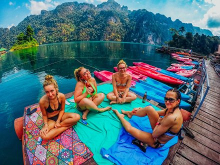 Four girls soaking up the sun at Khao Sok National park Thailand