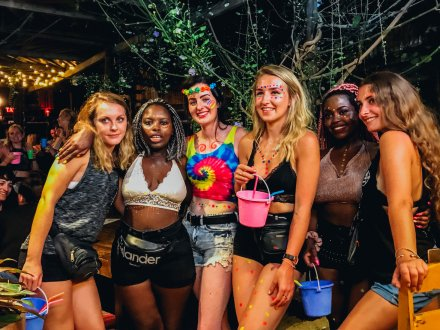 Full moon party group pictures with colourful buckets Koh Phangan Thailand