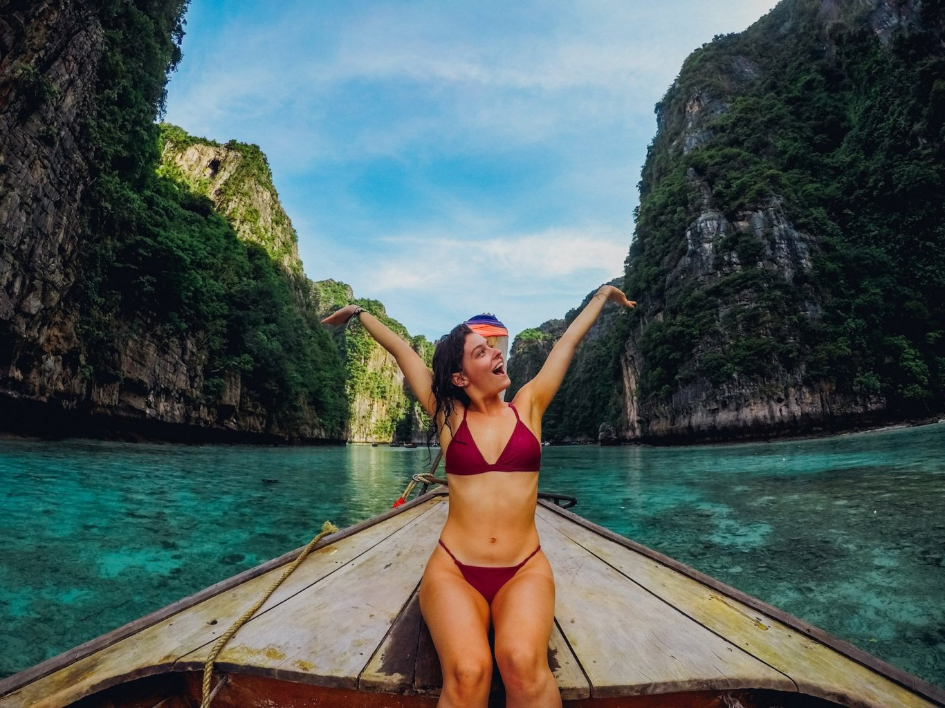 A girl on a boat at Maya bay in Koh Phi Phi Thailand