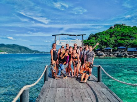 A group photo by turquoise water in Koh Tao