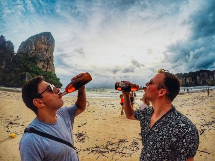 Drinking beer at Railay beach Thailand