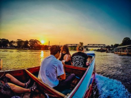 Admiring the sunset over the river Kwai from a long tail boat in Kanchanaburi Thailand