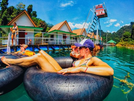 Relaxing in the donuts at the floating bungalows in Khao Sok National Park Thailand