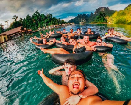 A group shot in donuts on the lake in Khao Sok National Park Thailand