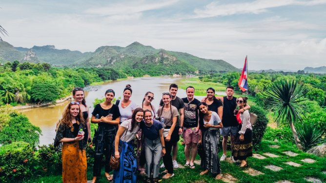 A group photo by the river Kwai in Kanchanaburi Thailand
