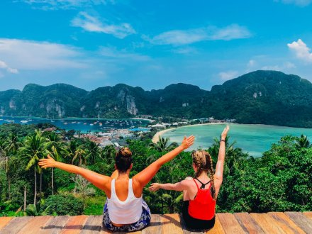 Two girls at the viewpoint in Koh Phi Phi Thailand overlooking the idyllic views