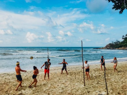 A group playing volleyball on the beach in Thailand Koh Tao