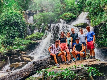 A group photo by the waterfall during the jungle trek in Chiang Mai Thailand