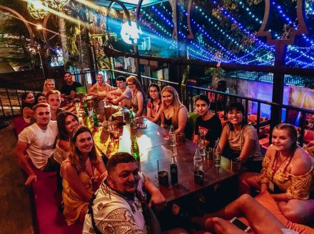 A group enjoying their welcome dinner on Khao San Road in Bangkok Thailand