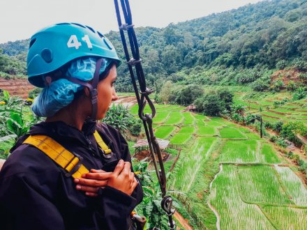 A girl about to go on the zip line in Chiang Mai Thailand