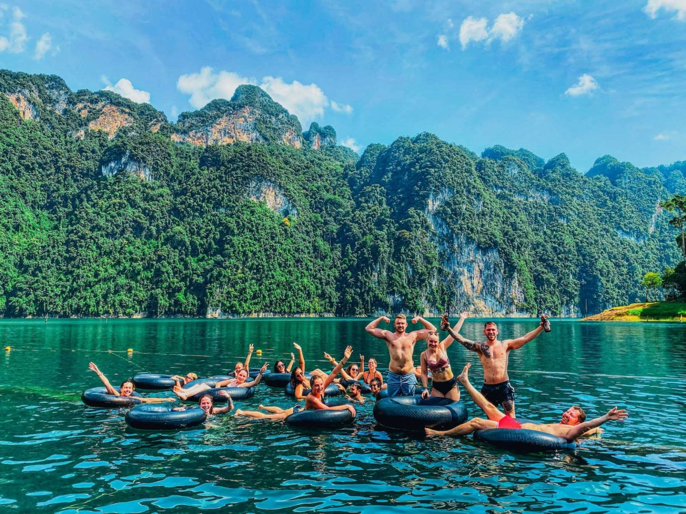 Group photos on the doughnuts in front of beautiful mountains in Khao Sok Thailand