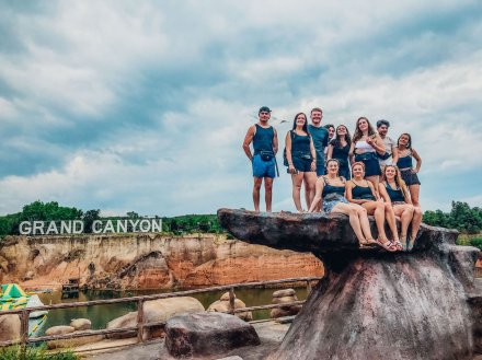 A scenic group picture on a boulder at Grand Canyon