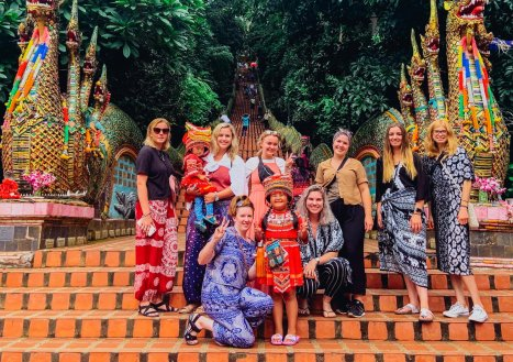A group photo at the beginning of the 300 steps at Wat Phra That Doi Suthep in Chiang Mai Thailand