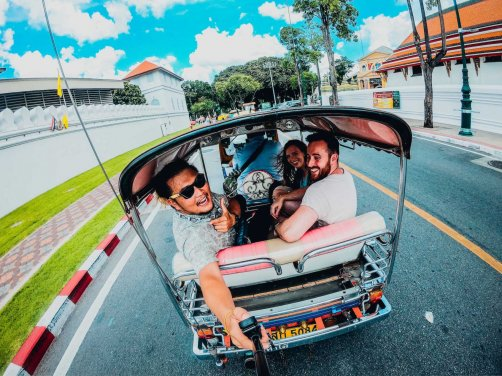 3 people laughing in tuk tuk in Thailand using a gopro to take photo