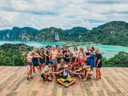 A group photo in front of Koh Phi Phi's stunning sea and land
