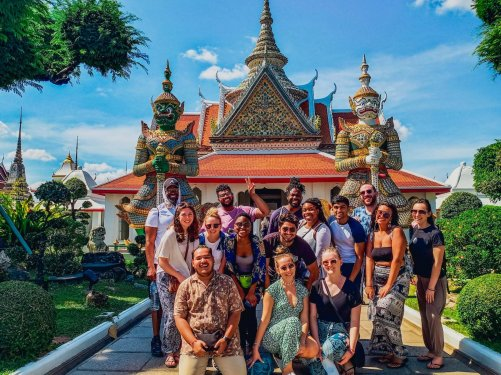 A group photo outside of Wat Pho in Bangkok Thailand on a sunny day